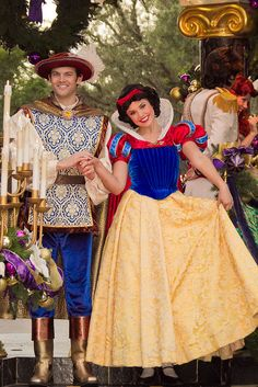 Snow White and Ferdinand. :-) I love Snow White's parade outfits! They have so much detail! She's so pretty (Snow White is my favorite princess).