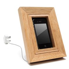 Frame cell phone holder designed to suit all phones and chargers. Frame can be mounted on a tabletop or wall.  I want one!