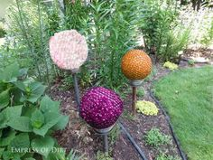 Garden art balls and more frugal  easy garden art projects  (dragonfly made from upcycled ceiling fan blades)