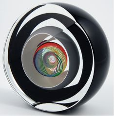 Ship in 2-3 weeks Like a distant planet surrounded by rings, a sphere of rainbow-colored glass cane nestles within alternating layers of black and clear glass. Dimensions: 4″H, 4″W, 2″D About the Arti