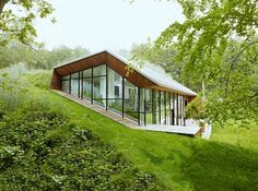 Dutch Mountain House by Denieuwegeneratie Architects. A stunning self sustainable house thats partially underground but has TONS of natural light, a garden on the roof and hidden bedrooms. Sustainable Architecture, Modern Architecture, Pavilion Architecture, Ancient Architecture, Residential Architecture, Earth Sheltered Homes, Earthship Home, Dutch House, Underground Homes