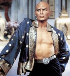 Yul Brynner in The King and I. I love that coat he is sporting. Great look for guys who want to go shirtless, but don't want to go completely bare chested.  - Luckypinup.com