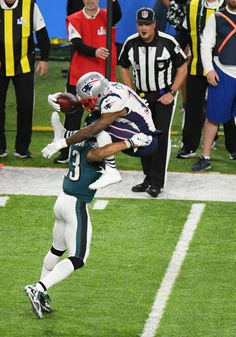 f100bca18 New England Patriots Wide Receiver Brandin Cooks tries to jump over  Philadelphia Eagles Safety Rodney McLeod