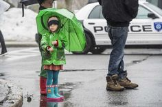 Eliah, 8, and Juniper Marbury, 4, from East Moriches, watch the Westhampton Beach St. Patrick's Day Parade along Main Street in Westhampton Beach, March 14, 2015. (Credit: Gordon M. Grant)