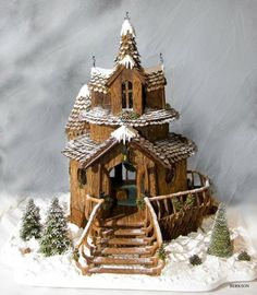 Amazing gingerbread house! It looks like carved wood! by graciela