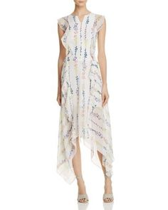 BCBGMAXAZRIA Jann Floral-Print Dress - 100% Exclusive $398.00 Designed exclusively for our 100% collection, BCBGMAXAZRIA's breezy silk chiffon dress ups the flirt factor with of-the-moment ruffles and a floral print.