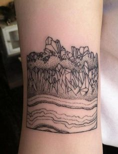 Great line work tattoo of a some kind of a mineral stone.