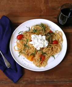 Pasta with cherry tomatoes, basil and ricotta. Get the recipe via @PureWow