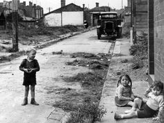 April 1946: Children play in a street within an area marked for demolition and reconstruction. Picture: Herald Sun Image Library