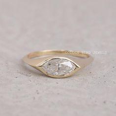 #BezelSetRing #AntiqueRing #DiamondRing #ColorlessMoissanite #MoissaniteRing #MarquiseRing #YellowGoldRing #GoldRingForHer #EngagementRing #KnifeEdgeShank #RingForHer #ColorlessMarquise #WeddingRingForHer