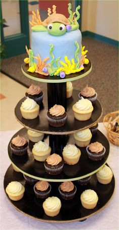 Cute turtle cake and cupcakes, maybe modify it for a Finding Nemo party?