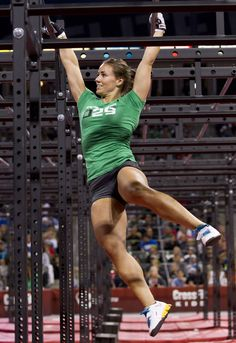 CrossFit Games 2011 competition Camille Leblanc-Bazinet The Killer Cage green graphic tee dark grey pro shorts white shoes Reebok