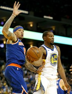 c665750f9 Golden State Warriors  Kevin Durant looks to pass against New York Knicks  Michael  Beasley in the second period of a NBA game at Oracle Arena in Oakland
