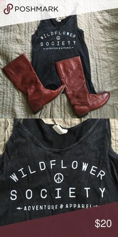 Wildflower society tank Heather black. Size medium. Runs huge. Would fit from medium to extra large easily depending on fit preference. I am normally a medium and it is too big for my style. Amazing small business. Local to the Outer Banks, North Carolina and Vermont. Tops Tank Tops