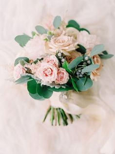 Gorgeous rose and eucalyptus bouquet: http://www.stylemepretty.com/2015/08/11/romantic-calgary-lake-house-wedding/ | Photography: Milton Photography - http://milton-photography.com/