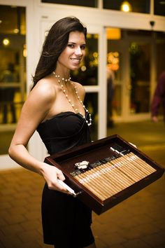 Cigar girls walking around with trays of cigars, at the high stakes tables, for a man of wealth and taste.