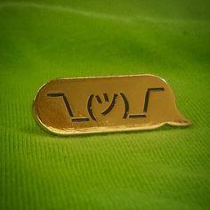 ¯\_(ツ)_/¯ lapel pin.