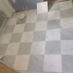 Checkerboard tile initial pattern layout for a kids' bathroom.  #marbletile #checkerboardtile #kidsbathroom #bathroomtile #carraramarble #honedmarble #naturalstone