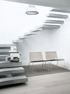 Floating Stairs are cool looking but they freak me out... kiddos and myself would just fall right off these dang things!!!