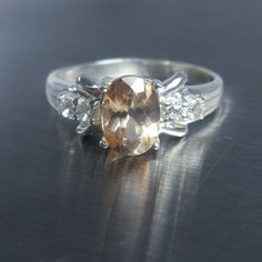 1ct Natural Axinite champagne colour 7x5mm & white topaz by EVGAD