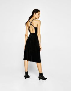 Velvet midi dress. Discover this and many more items in Bershka with new products every week
