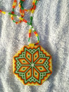 Native American made. Made in Montana. Beaded Medallion with dna strain necklace. Lot of time and effort put into this medallion Approximately 20-25 hours from start to finish. very colorful.