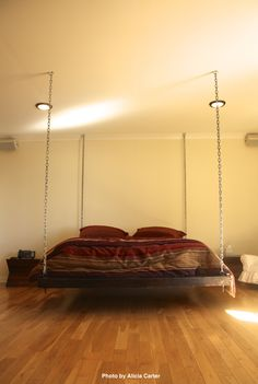 I am not sure about you, but we would be afraid this hanging bed would fall one night. We have never seen a hanging bed with metal chains on the corners.