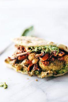 Naan-wich: 5 ingredient falafel, roasted veggies, and avocado sauce stuffed between pillowy garlic naan. Vegetarian / Vegan. | pinchofyum.com