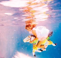 Elena Kalis captures whimsical and otherworldly scenes with underwater photography– her playful photos feature women and children suspended in the dreamy depths of Bahamian water, surrounded by props and costumes.