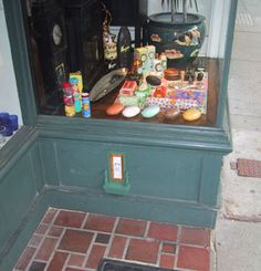 """Fairy Door: Peaceable Kingdom gift store.This particular location is especially cool. The fairies have set up a """"store"""" of their own inside. (click for pictures of interior)"""