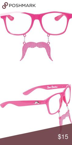 JUST IN! PINK MUSTACHE GLASSES Real bosses wear pink— and swag. Rock these Pink Sun-Staches so everyone at the mall knows what's up. This fun accessory features hot pink classic frames with clear lenses and a pink bedazzled Fu-Manchu-style moustache dangling underneath. These Sun-Staches glasses are made of sturdy plastic and have attached small, metal chains hanging the hard plastic moustache below your nose.  5 1/2in wide Plastic Attached moustache UV400 lenses One size fits most teens and…