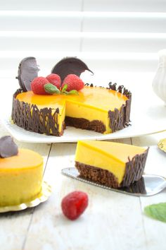Mango Mousse Cake with a great looking chocolate Genoise. Try our Mango Mousse Cake recipe, the recipe here and prepare to impress your family and friends. Mango Recipes, Sweet Recipes, Cake Recipes, Dessert Recipes, Mango Mousse Cake, Mango Cake, Just Desserts, Delicious Desserts, Yummy Food