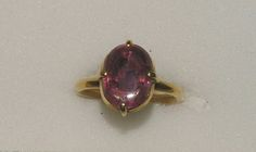 England circa 14th/15th centuray. Gold ring, oval bezel set with balas ruby (variety of spinel) held in for claws. Ashmolean Museum