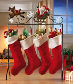 Need this for next year! Santa & Reindeer Floor Stocking Holder. Awesome if you don't have a mantle and don't want to put holes in the wall!