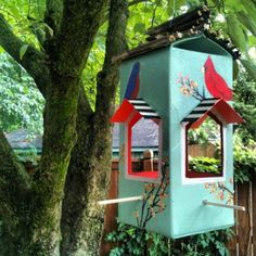 A hand-painted carton bird feeder. Complete with a perch and a sturdy stick roof. This is luxury bird feeding!