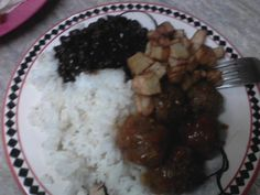 black beans,spanish meatballs,white rice and fry papitas
