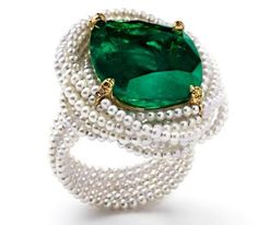 """SUSANNE SYZ """"La Colombiana Perfecta"""" ring set in 18k yellow gold and titanium with Colombian emerald and natural fine pearls."""