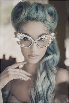 Victory Rolls, pastel blue hair and glitzy vintage glasses.