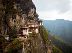 """High on the Himalayas' eastern edge, the Buddhist kingdom of Bhutan prides itself on """"low volume, hi. Oh The Places You'll Go, Places To Travel, Travel Destinations, Places To Visit, Bhutan, Couples Vacation, Tour Operator, Travel Photos, Tourism"""
