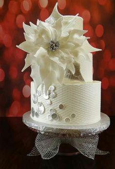 White and silver poinsettia cake