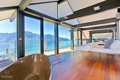 Simplicity is key. The view the lake the mountains and a unique bedroom in an exclusive villa in the heights of Montreux. Haus Am Hang, Villa, Lake Geneva, Interior Inspiration, In The Heights, Building A House, Beautiful Places, Windows, Bedroom