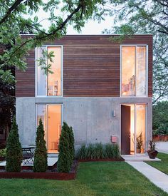 """In a South Minneapolis neighborhood of century-old housing stock, Julie Snow's bold but elegant residential design fulfilled Andrew Blauvelt and Scott Winter's desire for a loft on the ground.The home's mix of dark ipe wood, concrete, and glass give credence to Winter's description of it as """"an open bunker."""" Photo by Dean Kaufman."""