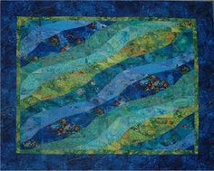 """Under the Stormy Sea"", 40 x 50"", pattern by Ruth Powers, featuring a stretched Storm at Sea block. The blocks are 10 x 20"" and the quilt only takes 6 blocks."