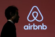 A man walks past a logo of Airbnb after a news conference in Tokyo, Japan, November REUTERS/Yuya Shino/File Photo -