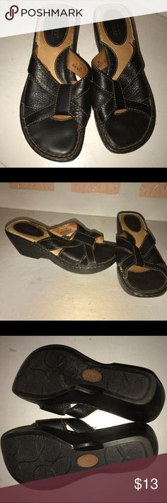Born Size 7 Black Slip On Sandals Born Size 7 Black Slip On Sandals.  These have been worn but are in good condition.   They are from a single owner both pet and smoke free home.   Please review all photos and ask questions prior to purchase. Born Shoes Sandals