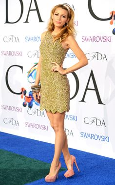 Blake Lively looks extra glitzy in a golden mini dress with a scalloped hemline and a stack of bangles.