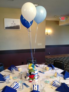 """Diaper cakes for the centerpieces. The plush characters came from Ebay. Popcorn boxes with """"She's Ready To Pop Stickers"""" on the popcorn bags and """"Where's the Kaboom"""" from Marvin the Martian on the front."""