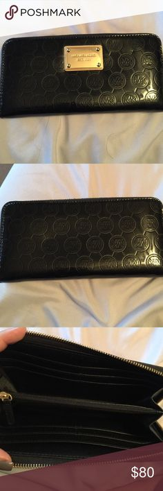 Michael Kors Black Wallet great condition! some scratches on gold piece Bags Wallets