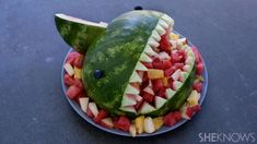 Kids and adults alike will love this friendly shark carved from a watermelon and filled with a fresh fruit salad.