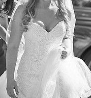 New gown, unaltered. Sweetheart neckline, lace overlay, ivory color with beautiful train! Size 6 label.